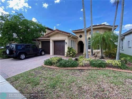 Photo of 10685 NW 83rd Ct, Parkland, FL 33076 (MLS # F10229947)