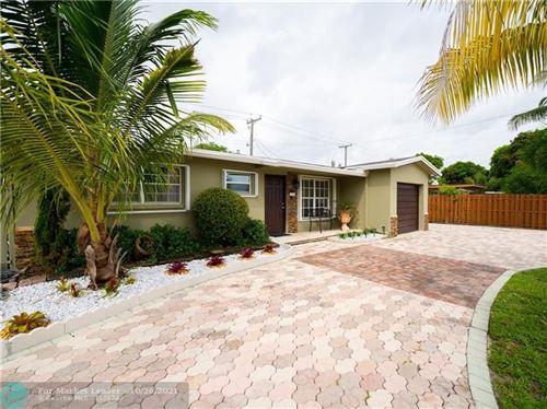 Photo of 4521 NE 1st Terrace, Pompano Beach, FL 33064 (MLS # F10305948)