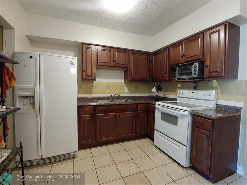 Photo of 6823 SW 19th St, North Lauderdale, FL 33068 (MLS # F10265950)