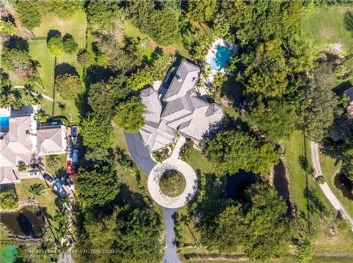 Photo of 9101 NW 66th Ln, Parkland, FL 33067 (MLS # F10268953)