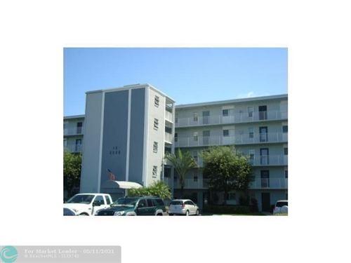 Photo of 2220 N Cypress Bend Dr #308, Pompano Beach, FL 33069 (MLS # F10283953)