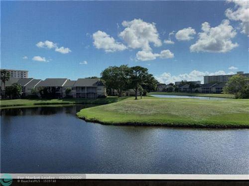 Photo of 2823 N Course Dr #208, Pompano Beach, FL 33069 (MLS # F10199959)