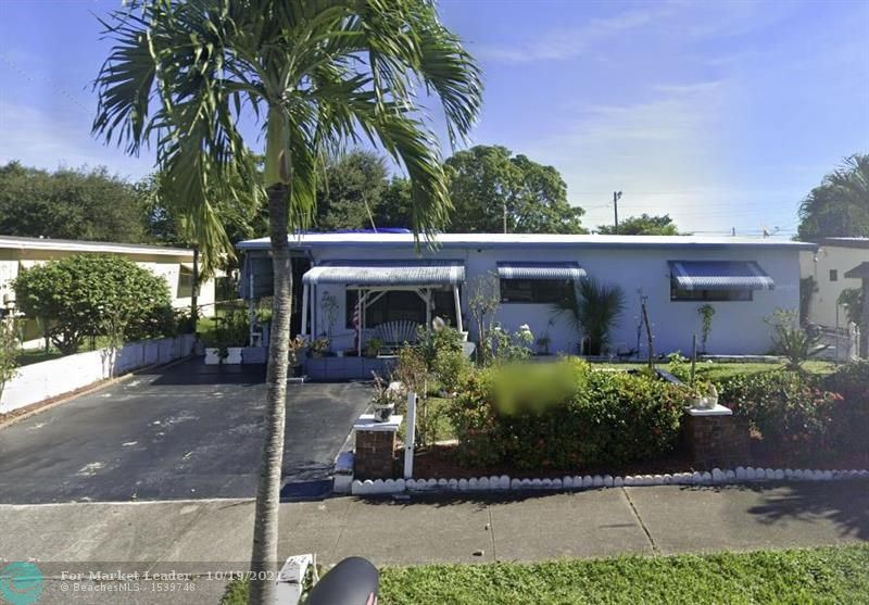 Photo of 254 NW 30th Ter, Fort Lauderdale, FL 33311 (MLS # F10304959)