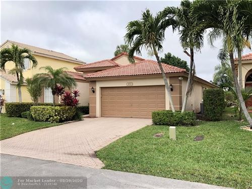 Photo of 4573 NW 7th Pl, Deerfield Beach, FL 33442 (MLS # F10218963)