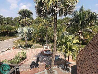 Photo of 11305 86th St, Palm Beach Gardens, FL 33412 (MLS # F10289965)