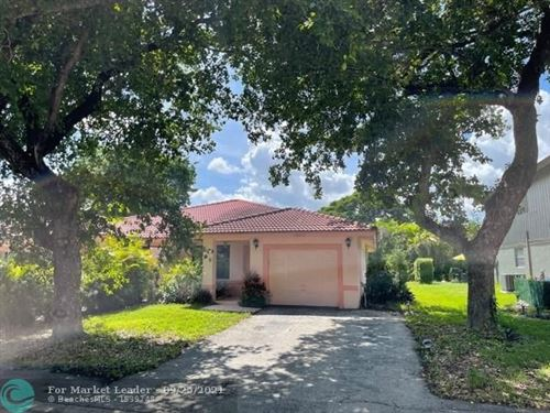 Photo of 12050 NW 33rd St, Coral Springs, FL 33065 (MLS # F10301972)
