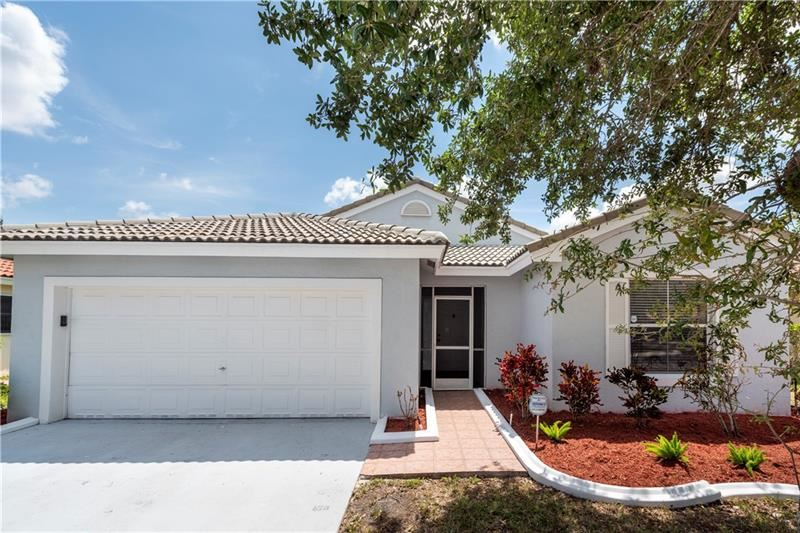 Photo of 415 NW 165th Ave, Pembroke Pines, FL 33028 (MLS # F10282973)
