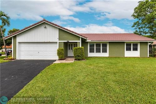 Photo of 10791 NW 21st St, Coral Springs, FL 33071 (MLS # F10305978)