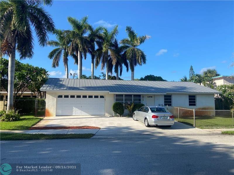 Photo of 122 E 30th St, Riviera Beach, FL 33404 (MLS # F10300978)
