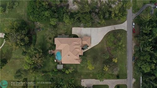 Photo of 6565 NW 66th Ave, Parkland, FL 33067 (MLS # F10217979)