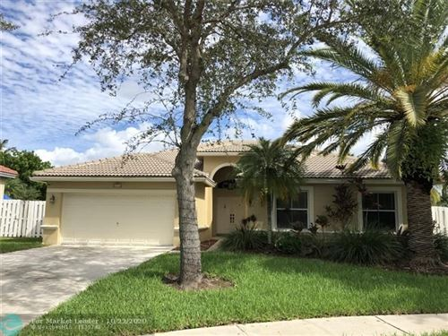 Photo of 2311 NW 193rd Ave, Pembroke Pines, FL 33029 (MLS # F10254981)