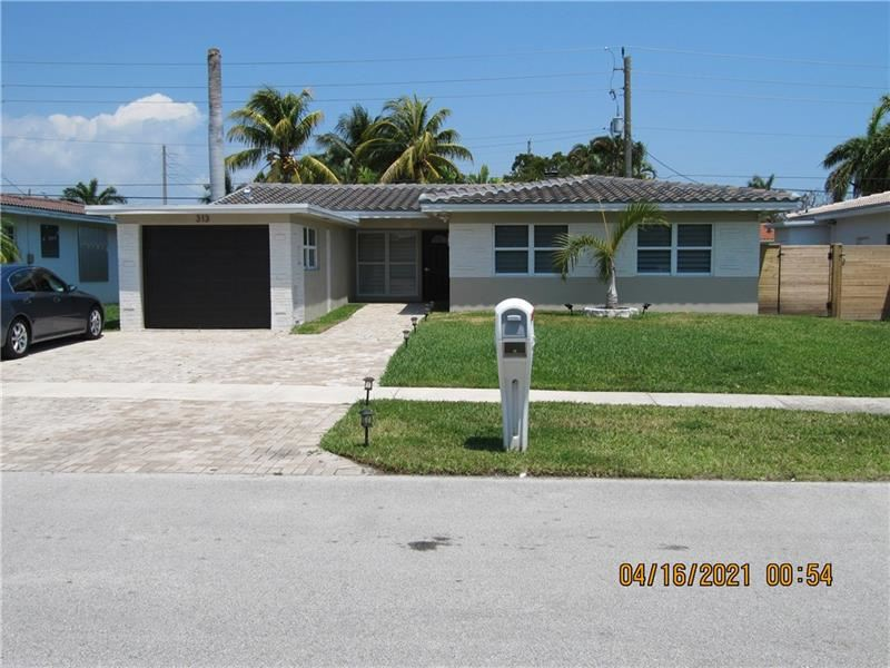 Photo of 313 SE 3rd Pl, Dania Beach, FL 33004 (MLS # F10280990)