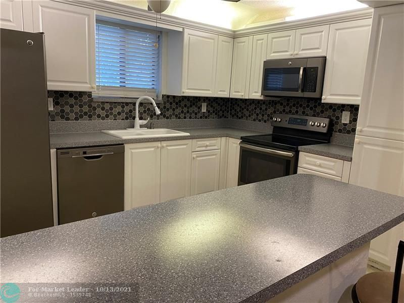 Photo of 9503 SW 1st Ct #9503, Coral Springs, FL 33071 (MLS # F10296990)
