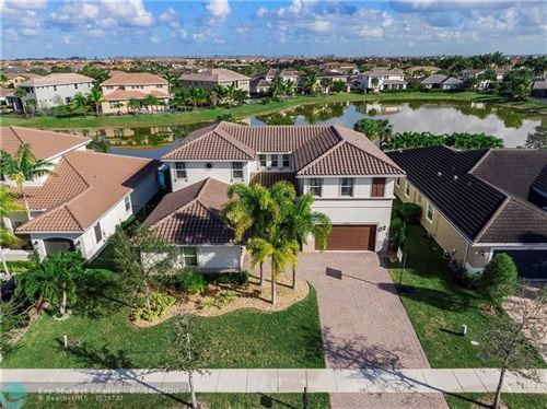 Photo of 11833 NW 79th Ct, Parkland, FL 33076 (MLS # F10238991)