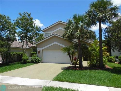 Photo of 7600 NW 70th Ave, Parkland, FL 33067 (MLS # F10240992)