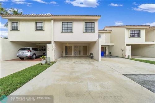 Photo of 207 NW 45th Ave, Deerfield Beach, FL 33442 (MLS # F10305996)