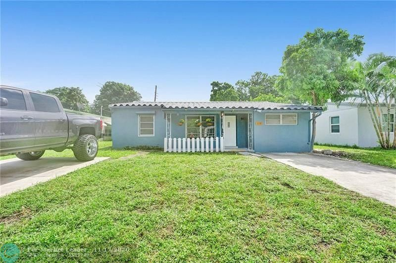Photo of 110 NW 52nd St, Oakland Park, FL 33309 (MLS # F10258997)