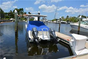 Photo of 38 Ft. Boat Slip at Gulf Harbour B-23, FORT MYERS, FL 33908 (MLS # 218033207)