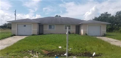 Photo of 2401/2403 Xelda Avenue N, LEHIGH ACRES, FL 33971 (MLS # 219080288)