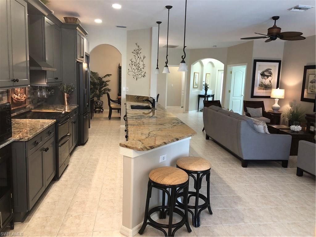 Photo of 8565 Brittania Drive, FORT MYERS, FL 33912 (MLS # 220045310)