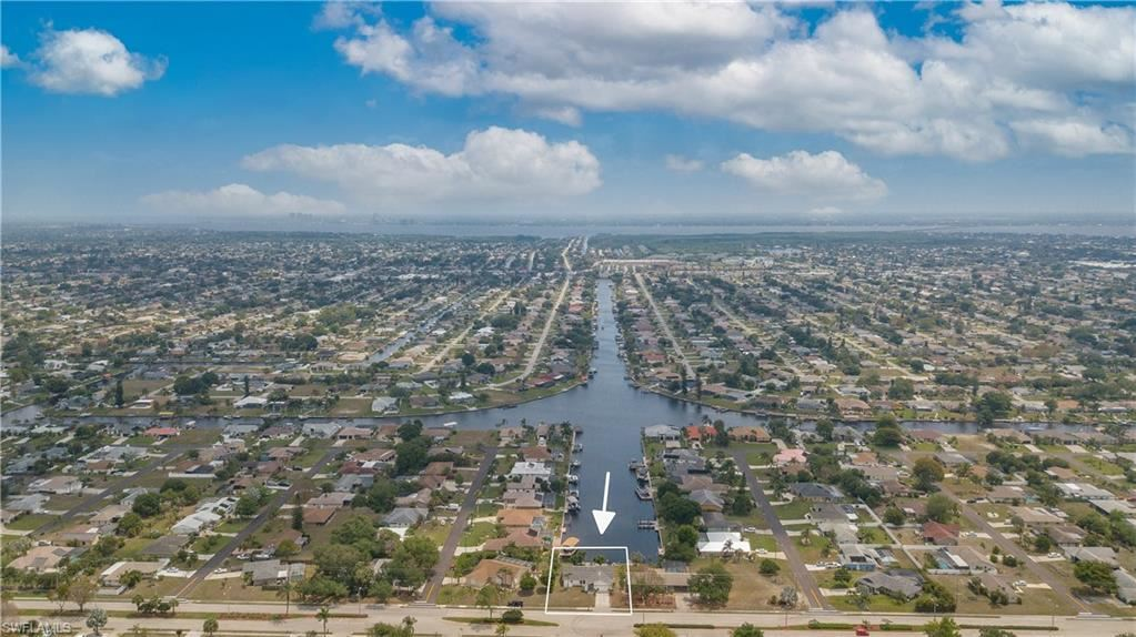 1625 Country Club Boulevard, Cape Coral, FL 33990 - #: 221029357