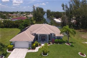 Photo of 409 SW 15th TER, CAPE CORAL, FL 33991 (MLS # 218004386)