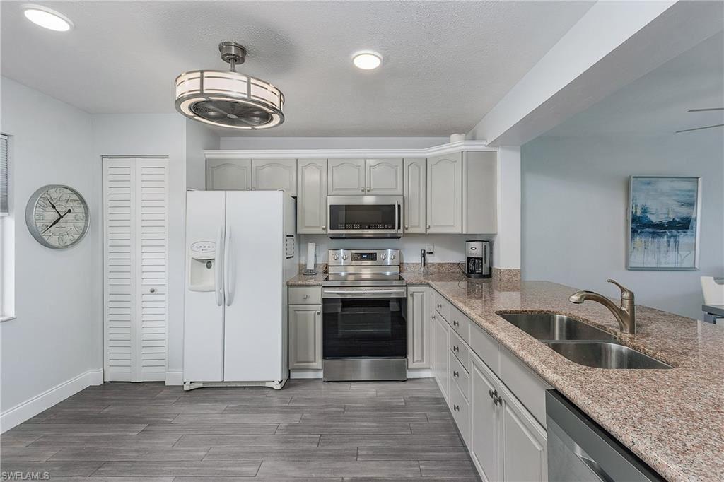 Photo of 9900 Sunset Cove Lane #123, FORT MYERS, FL 33919 (MLS # 220056433)