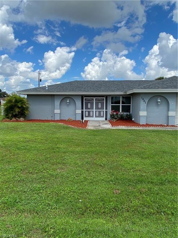 1407 Graham Circle E, Lehigh Acres, FL 33936 - #: 221069442