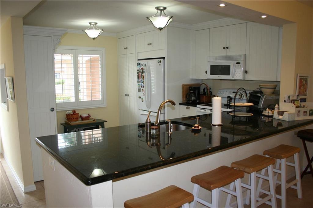 Photo of 9900 Sunset Cove Lane #112, FORT MYERS, FL 33919 (MLS # 220057499)