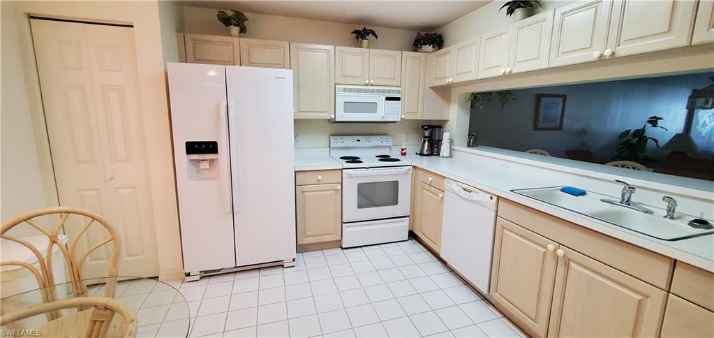 Photo of 9435 Sunset Harbor Lane #214, FORT MYERS, FL 33919 (MLS # 220064630)
