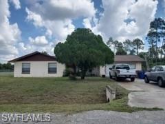 Photo of 720 Calvin Avenue, LEHIGH ACRES, FL 33972 (MLS # 220061645)