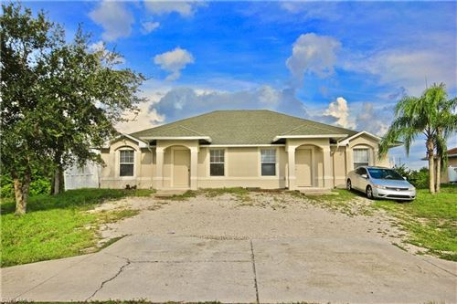 Photo of 1521/1523 Hightower Avenue S, LEHIGH ACRES, FL 33973 (MLS # 220034701)