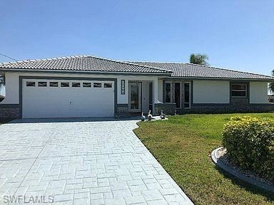 Photo of 1164 SW 43rd Street, CAPE CORAL, FL 33914 (MLS # 221029841)