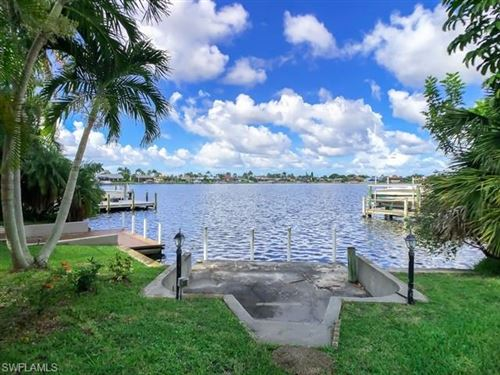 Photo of 526 Cape Coral PKY W, CAPE CORAL, FL 33914 (MLS # 219054946)