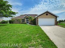 2409 Crawford Avenue N, Lehigh Acres, FL 33971 - #: 220036976
