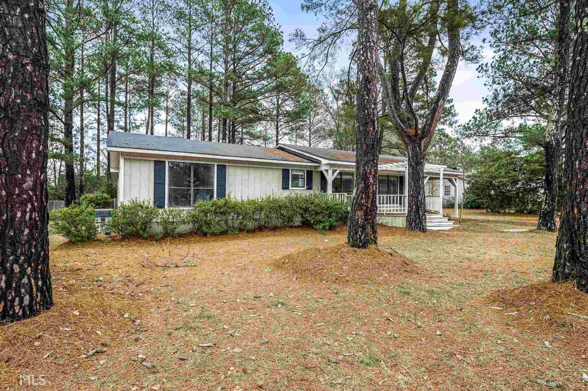 Photo of 619 Harrison St, Sandersville, GA 31082 (MLS # 8856002)