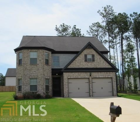 Photo of 67 Pulaski Ave., Hampton, GA 30228 (MLS # 8820149)