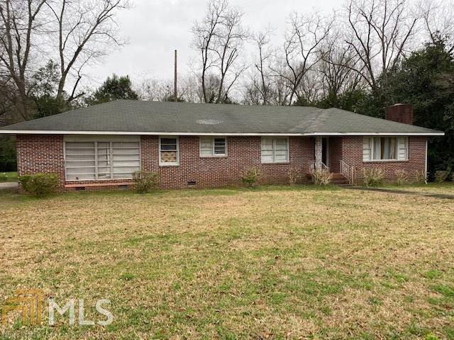 Photo of 404 Washington Ave, Sandersville, GA 31082 (MLS # 8936179)