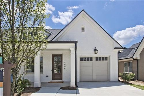 Photo of 4858 Noble Village Way, Lilburn, GA 30047 (MLS # 8854181)