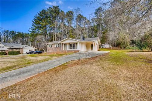 Photo of 854 Hickory Ridge Rd, Lilburn, GA 30047 (MLS # 8926243)