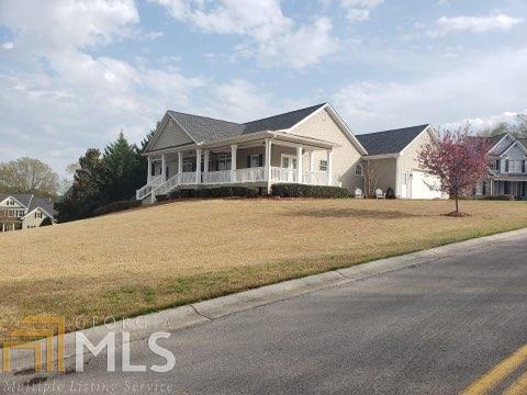 Photo of 100 Hunters Pt, Calhoun, GA 30701 (MLS # 8763431)