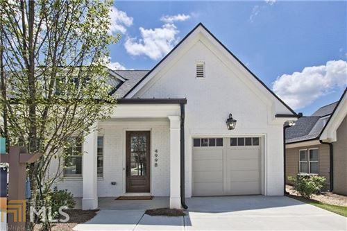 Photo of 4828 Noble Village Way, Lilburn, GA 30047 (MLS # 8927485)