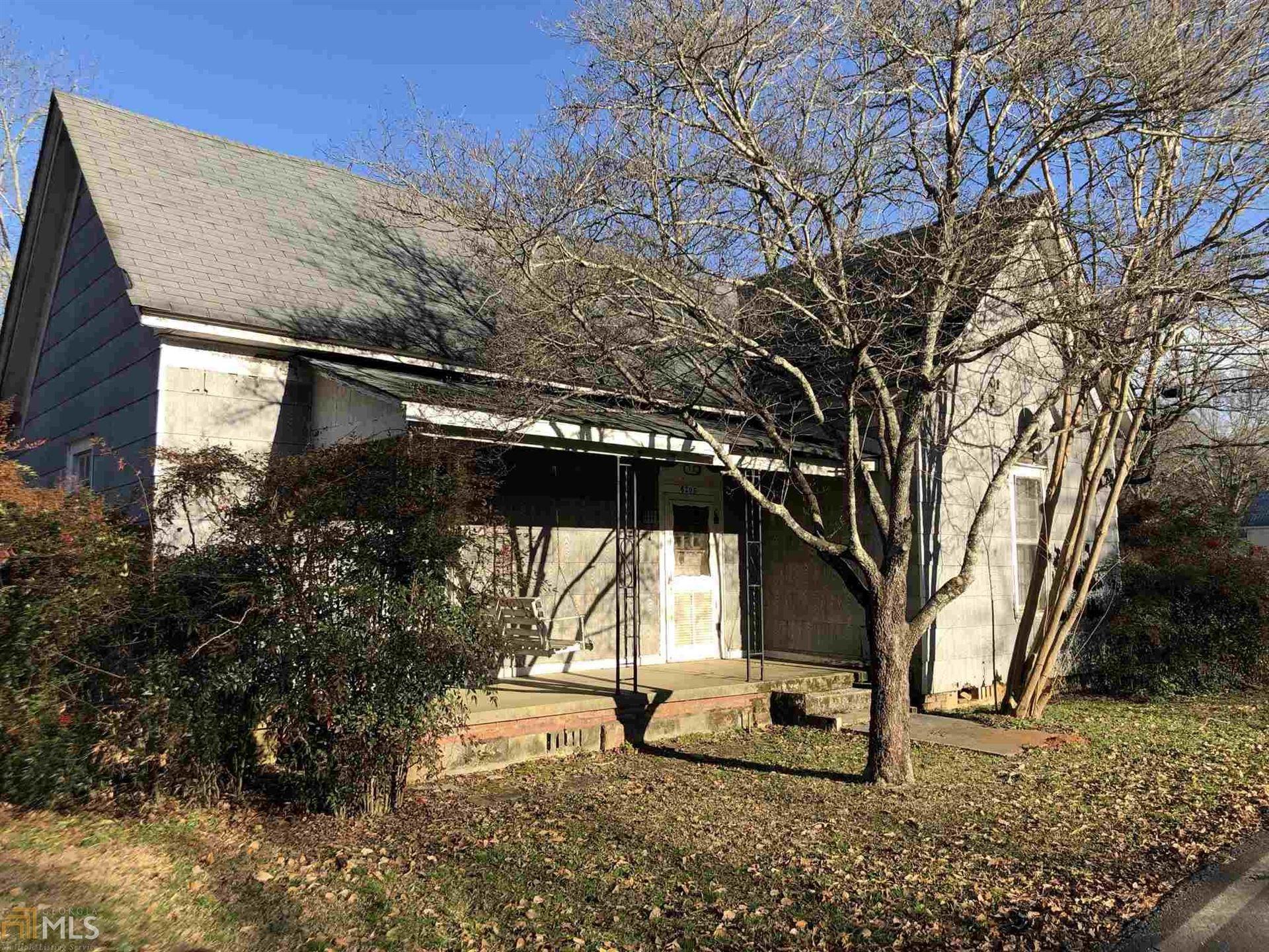 Photo of 6205 Collins St, Covington, GA 30014 (MLS # 8928647)