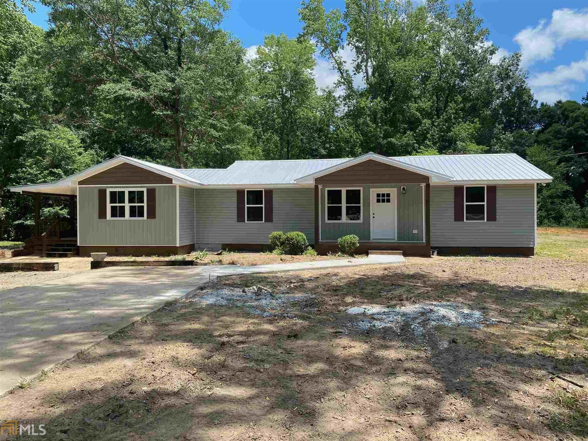 Photo of 700 Henderson Grv, Sandersville, GA 31082 (MLS # 8809689)