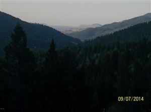 Photo of Lone Larch  DR #41, WOLF CREEK, MT 59648 (MLS # 18-1099)