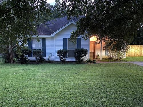 Photo of 71113 LAKE PLACID Drive, Covington, LA 70433 (MLS # 2282279)