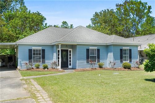 Photo of 71239 LAKE PLACID Drive, Covington, LA 70433 (MLS # 2296359)