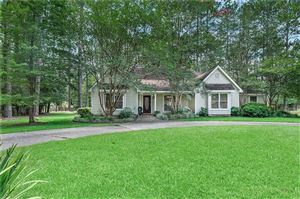 Photo of 1 RAMBLEWOOD Drive, Covington, LA 70435 (MLS # 2209569)