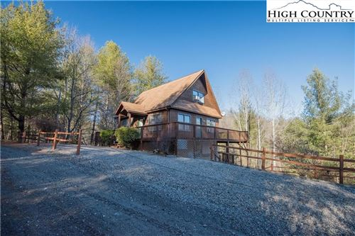 Photo of 111 HAPPY FOREST Drive, Piney Creek, NC 28663 (MLS # 219294)