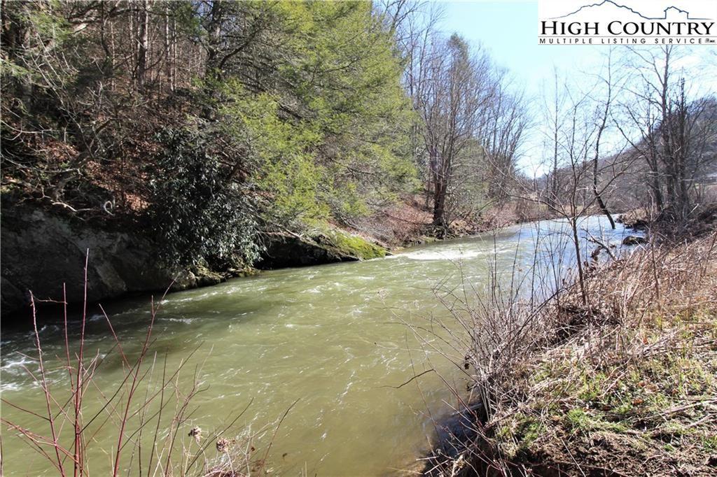Photo of 9205 NC Highway 16, Grassy Creek, NC 28631 (MLS # 220385)